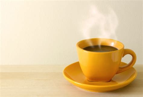 steaming coffee cup on table photo free