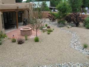 xeriscape backyard w flagstone fire pit dry river bed