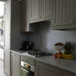 grey kitchen rosa beltran design affordable brass cabinet hardware