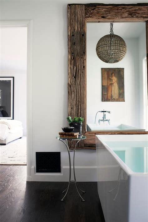 superb Master Bathroom Mirror Ideas #2: reclaimed-wood-mirror-above-bathtub-old-hollywood-style-chandelier.jpg