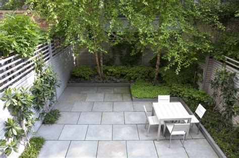 landscaping small backyards townhouse tidy urban garden large scale bluestone pavers angular