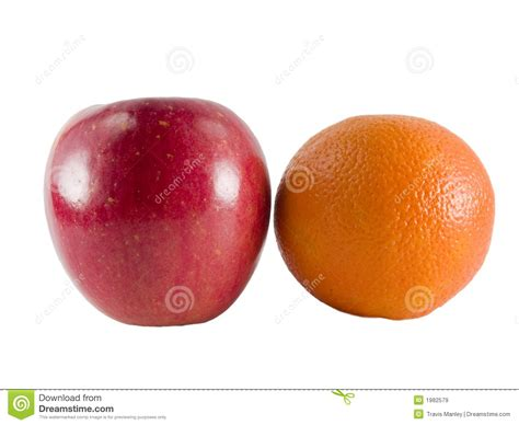 Comparing Apples To Oranges by Comparing Apples To Oranges Royalty Free Stock Images