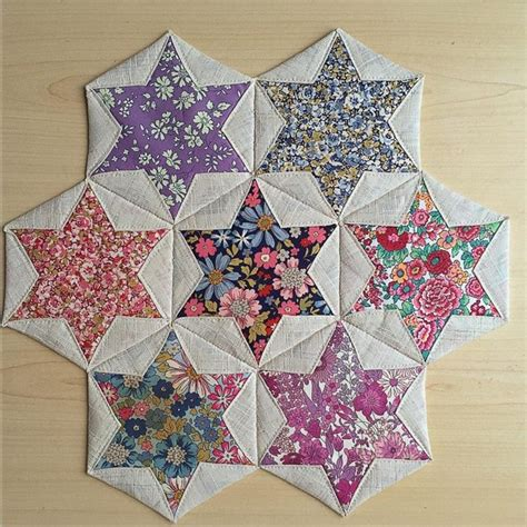 Folded Patchwork Patterns - folded hexagon make a pretty table mat quilting digest