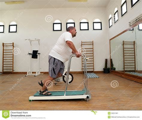 how to a to run on a treadmill overweight running on trainer treadmill stock photo image 39251981