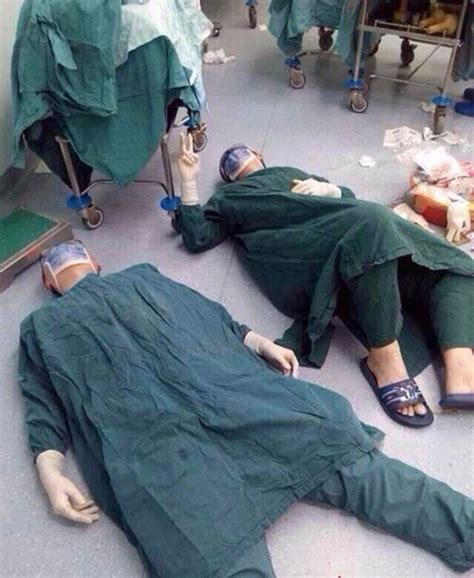 After Sadturday two surgeons collapse on the floor after 32 hour surgery