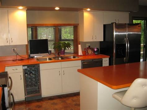 orange countertop with white cabinets for the kitchen