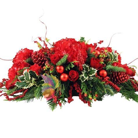 composizioni fiori natalizi mantello rosso spediamo fiori dolci e regali a domicilio
