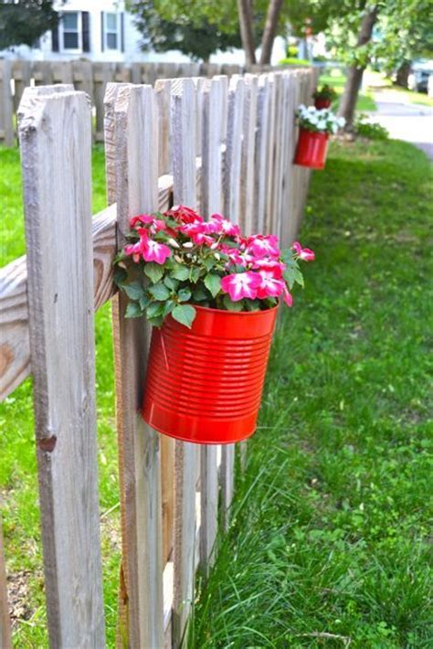 fence hanging planters upcycling cans to diy hanging fence planters citronella plant planters and hanging planters