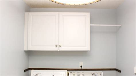 How To Install Cabinets In Laundry Room Installing Wall Cabinets In Laundry Checking In With Chelsea
