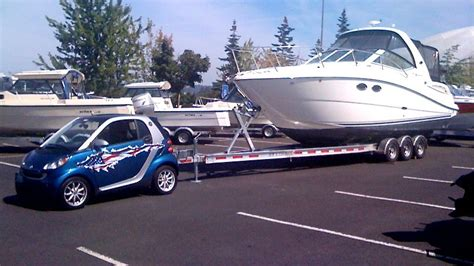 tow cer and boat towing with vehicles not really meant for towing