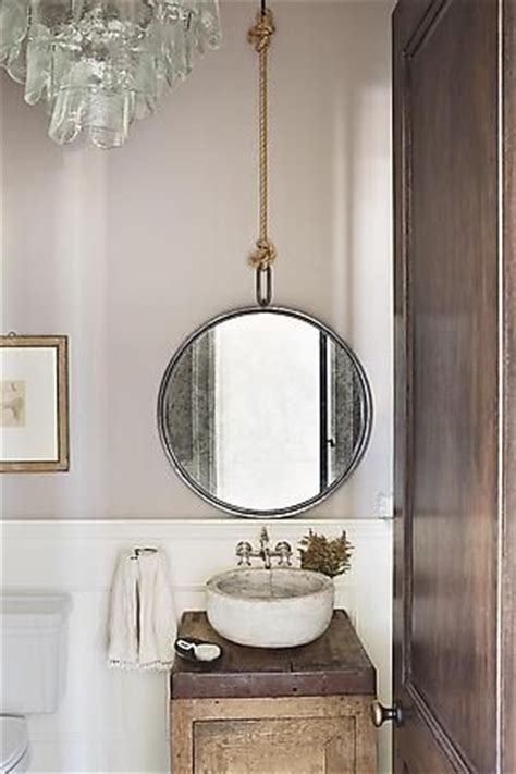 perfectly polished rustic the rope hanging the mirror the tiny sink makes this