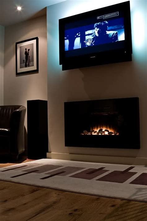 contemporary fireplace with tv above for the home