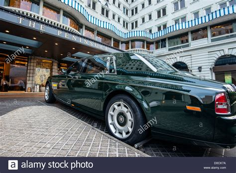 rolls royce outside a green painted rolls royce phantom parked outside the