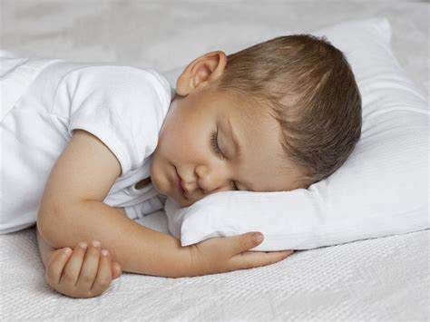 When Can Baby Sleep With Pillow by When Can Child Sleep With A Pillow Babycenter