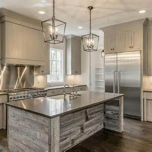 Gray shiplap kitchen hood with stainless steel cooktop backsplash