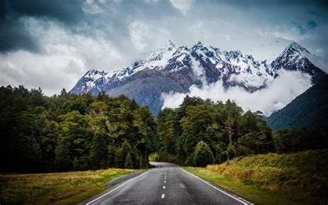 road landscape mountains clouds forest  zealand