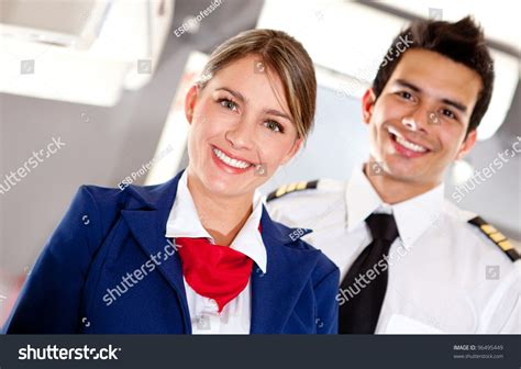 airplane cabin crew pilot flight attendant stock photo