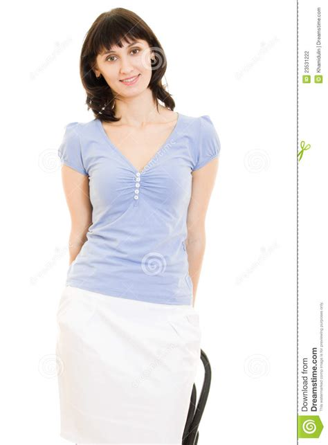 attractive in a blue shirt and white skirt stock