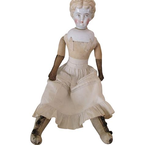 china doll expression antique blond china doll with serene expression