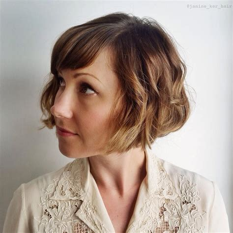 loose curls on chin lenght bob 50 classy short bob haircuts and hairstyles with bangs