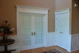 wainscoting door integrate window and door trim with wainscoting panels