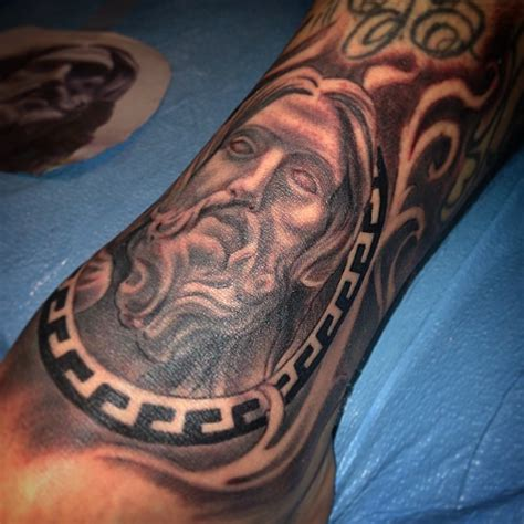 christian tattoo artist bay area religious statue jesus christ versace filigree tattoo by