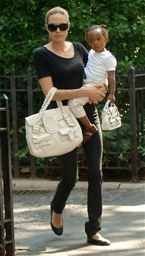 Bag For Babies Zahara Joli Pitt With Valentino Histoire Bag by And Zahara S Matching Valentino Handbags Purseblog