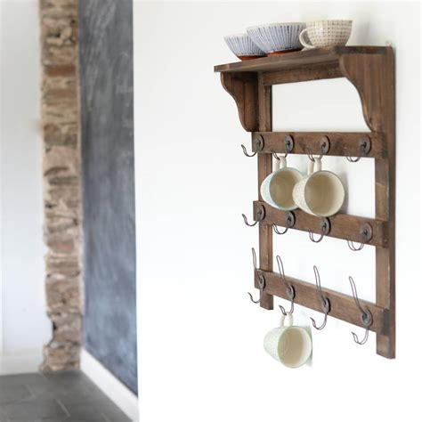 wooden wall shelf with hooks by the forest co