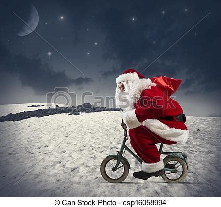 imagenes de santa claus en bicicleta stock de fotografos de bicicleta claus santa santa