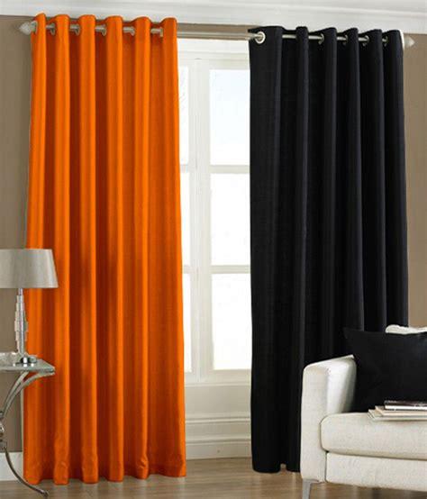 orange and black curtains pindia set of 2 window eyelet curtains solid black orange