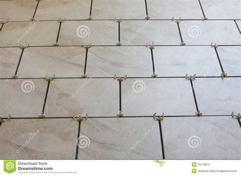 Installation Of Floor Tiles And Spacers Stock Photo