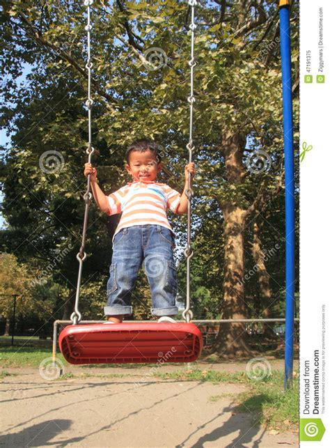 japan swing japanese boy on a swing stock photo image 47191375