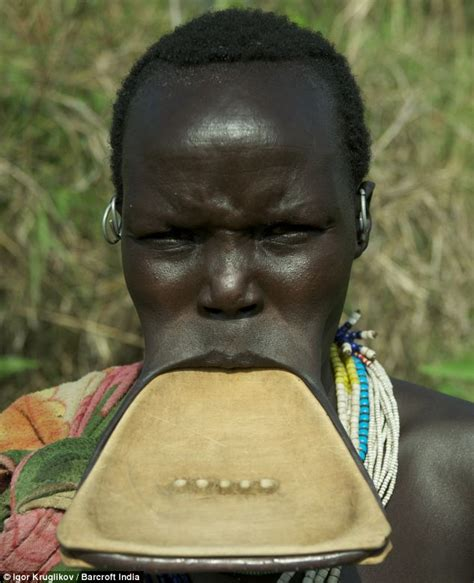 lips tattoo in ghana incredible images capture the ethiopian suri tribe whose
