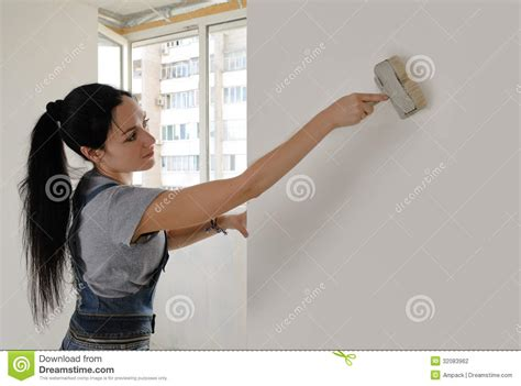Kitchen Cabinets Painters by Attractive Woman Painting A House Wall Stock Photography