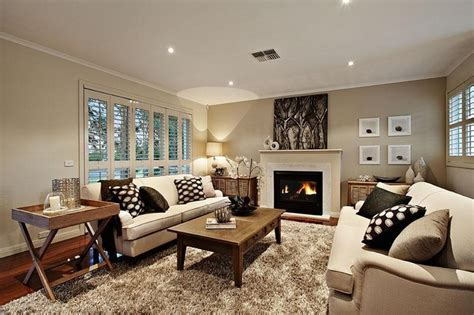 hton style living room with fireplace and feature wall
