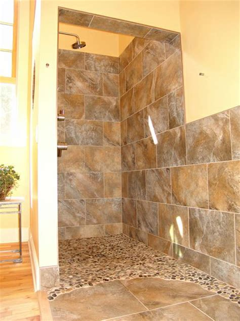 doorless curbless tile shower with river rock floor and 17 best images about bathroom ideas for condo on pinterest