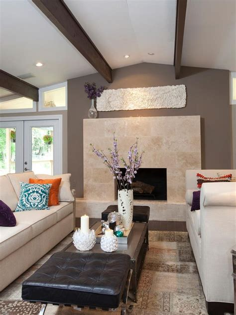 neutral transitional family room with curved sofa and a neutral sofa and chaise face each other in this