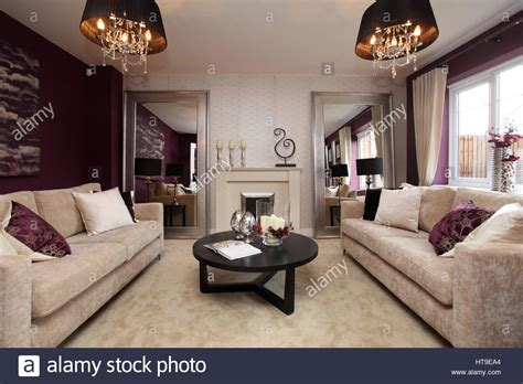 purple and beige living room home interior lounge living room purple decor purple feature stock photo royalty free image
