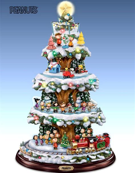 christmas tabletop musical rotating christmas tree decoration a peanuts tabletop tree with lights and motion rotating skaters and