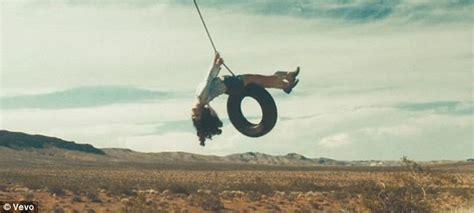 lana del rey tire swing lana del rey turns promiscuous wild child in 10 minute