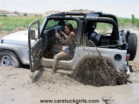 muddy jeep wrangler jeep wrangler mud stuck on the lake