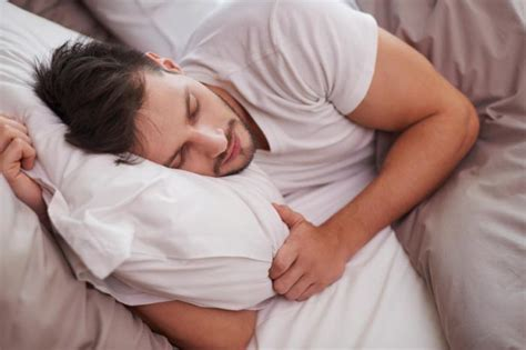 man sleeping in bed diabetes risk increased for men who get too much too