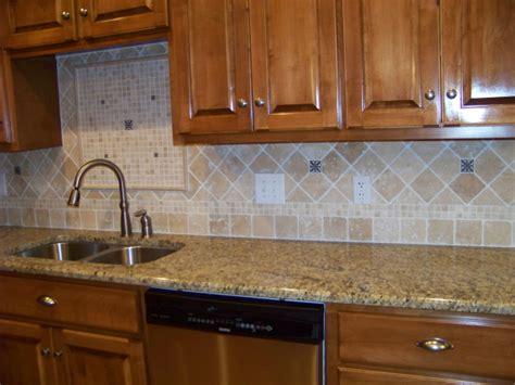 medium brown cabinets with granite countertops medium brown stained cabinets with venetian gold