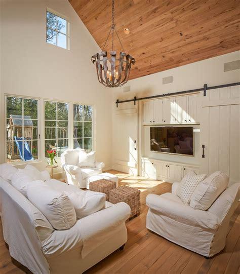 hiding tv in living room tv cottage living room thompson custom homes