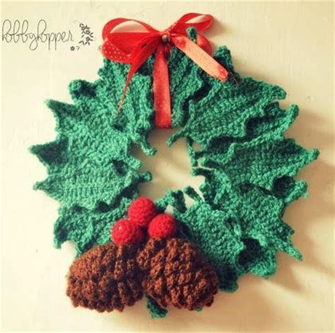 Wintry Pine Cone and Holly Wreath   AllFreeCrochet.com