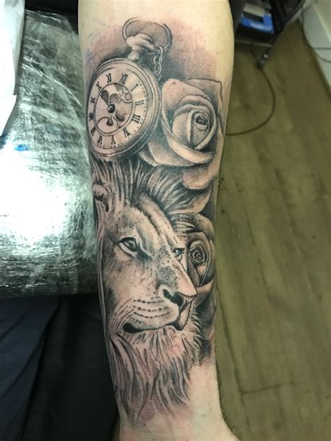 lion and rose tattoo clock tattoos lions