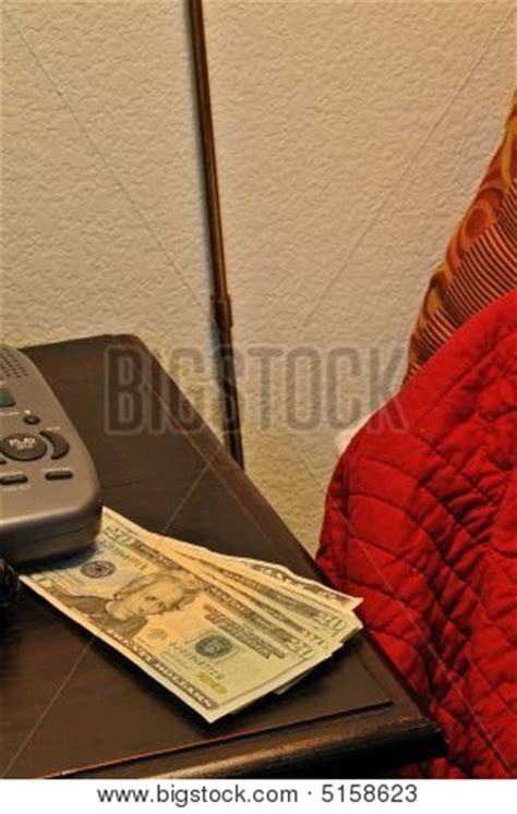 money on a bed money on the bed stock photo stock images bigstock