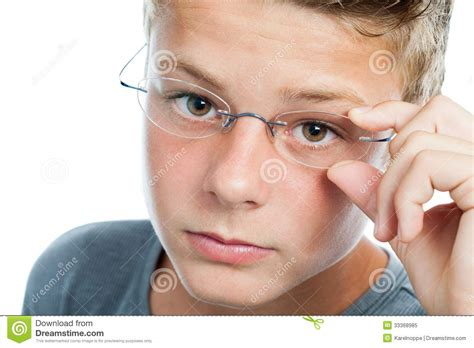 young boys faces face shot og boy wearing glasses royalty free stock photo