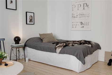 bed in living room bed living room with dark touches coco lapine designcoco lapine design