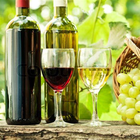 wine bottles  glasses  bunch  grapes  basket